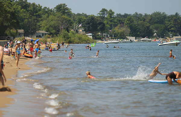 Record-Eagle/Keith King<br /> People gather at the Keith J. Charters Traverse City State Park beach on East Grand Traverse Bay.