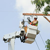 Record-Eagle/Keith King<br /> Tom Ulatowski, with Cherryland Electric Cooperative, works on a power line reconductoring project on Edgewood Avenue in Long Lake Township.