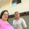 Record-Eagle/Glenn Puit<br /> Sandy Eytcheson, left, and Sarah Miner stand outside Tower Hill Adult Foster Care in Traverse City.