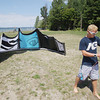 Record-Eagle/Keith King<br /> Ashton Lawton, of Traverse City, prepares to take advantage of the wind by kiteboarding Friday, August 9, 2013 on East Grand Traverse Bay at Bayside Park in Acme.