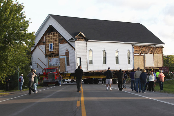 Record-Eagle/Keith King<br /> Work takes place Tuesday, August 13, 2013 to move St. Joseph Catholic Church onto Center Road, near Blue Water Road, toward its new location near the parish cemetery on Old Mission Peninsula.