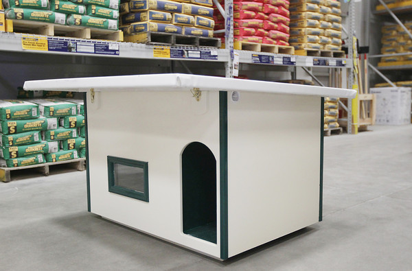 Record-Eagle/Keith King<br /> A doghouse built by Mike Schulte, of Traverse City, stands Tuesday, August 6, 2013 at Lowe's in Traverse City. The doghouse, which was built for AC Paw, is built to be durable and weather resistant while having ventilation to allow for cool temperatures in the summer and warmer temperatures in the winter.