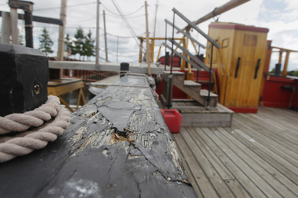 Record-Eagle/Keith King<br /> Evidence of rotting wood is visible Tuesday, August 13, 2013 on the rail cap of the Armed Sloop Welcome in West Grand Traverse Bay.
