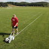 Record-Eagle/Keith King<br /> Patti Leasure, Traverse Bay Area Youth Soccer (TBAYS) office manager and juniors program director, paints field lines Thursday, August 15, 2013 at the Keystone Soccer Complex. A TBAYS recreation program is scheduled for September 7 at the complex and the 2013 Autumn Classic soccer tournament is scheduled for September 21 and 22.