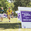Record-Eagle/Keith King<br /> Kelly and Randy Vasher, members of a team from Saint Ann Catholic Church, in Frankfort, along with other participants, walk Saturday, August 10, 2013 during the Benzie County Relay for Life at Memorial Park in Benzonia.