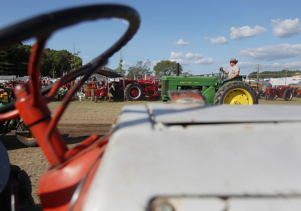 Record-Eagle/Keith King<br /> Mike Pratt, of Frederic, drives his 1957 John Deere 70 diesel tractor Thursday, August 15, 2013 during the 46th annual Buckley Old Engine Show which is scheduled through Sunday.