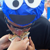 Record-Eagle/Jan-Michael Stump<br /> Keith Conway, dressed as Cookie Monster, is fed a cherry pie by Birgit Yetter as the final challenge of the Cherry Roubaix Cruiser Classic Saturday in Traverse City.