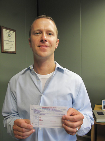 Record-Eagle photo/Brian McGillivary <br /> Traverse City Clerk Ben Marentette holds a copy of a ballot application issued by the Michigan Secretary of State that shows the citizenship question that angered some voters.