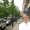 Record-Eagle/Glenn Puit<br /> Traverse City attorney Daniel Myers stands on Front Street recently. Myers regularly defends consumers sued by debt collection companies and said there's a significant increase in those types of cases in the Grand Traverse region.