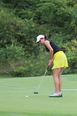 Record-Eagle/Keith King<br /> Traverse City Central's Amelia Pezzetti putts the ball during the Traverse City Central Bob Lober Classic at the Grand Traverse Resort and Spa.