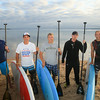 Record-Eagle/Keith King<br /> Andrew Pritchard, from left, Kwin Morris, Jeff Guy, Joe Lorenz and Joel Mueller stand at West Grand Traverse Bay. The group are planning to travel on Lake Michigan, using stand-up paddleboards, from Algoma, Wisconsin to Frankfort, Michigan to raise money for Alliance for the Great Lakes.