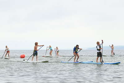 Record-Eagle/Keith King A youth stand-up-paddle board race takes place on West Grand Traverse Bay during the TC Waterman Challenge and Expo on West Grand Traverse Bay.