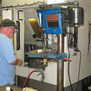 Record-Eagle/Carol Thompson <br /> Machinist Terry Boursaw prepares parts that will be made into rod holders at the Big Jon Sports manufacturing facility in Interlochen. Boursaw was hired at the sporting goods company one year ago and works in the machine shop.