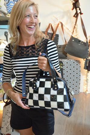 Record-Eagle/Allison Batdorff<br /> Nicole Van Dyke shows a bag of her own design at Impromptu Design in Suttons Bay.