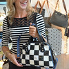 Record-Eagle/Allison Batdorff<br /> Nicole Van Dyke shows a bag of her own design at Impromptu Design in Suttons Bay.