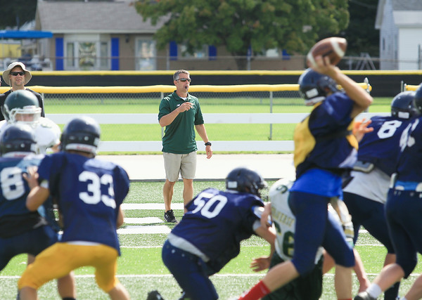 Record-Eagle/Keith King<br /> Tim Wooer, Traverse City West Senior High School varsity football head coach, looks on during a scrimmage between Traverse City West and Mount Pleasant at Thirlby Field.
