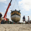 Record-Eagle/Keith King<br /> The armed sloop Welcome is supported after being lifted out of West Grand Traverse Bay. The vessel is now planned to be taken to the Headlands International Dark Sky Park in Mackinaw City.