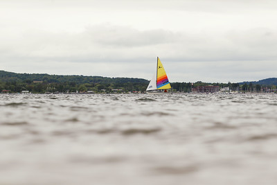 Record-Eagle/Keith King A sailboat travels under a cloudy sky on West Grand Traverse Bay.