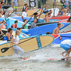 Record-Eagle/Keith King<br /> Stand-up-paddle boards are carried by racers into West Grand Traverse Bay during the TC Waterman Challenge and Expo in Traverse City.