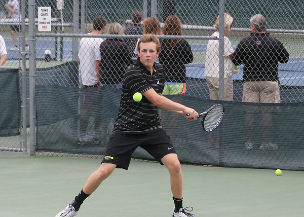 Record-Eagle/Keith King Traverse City Central's Ron Dohm competes at No. 2 doubles against Rochester during the Traverse City Central Summer Splash Invitational.
