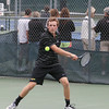 Record-Eagle/Keith King<br /> Traverse City Central's Ron Dohm competes at No. 2 doubles against Rochester during the Traverse City Central Summer Splash Invitational.
