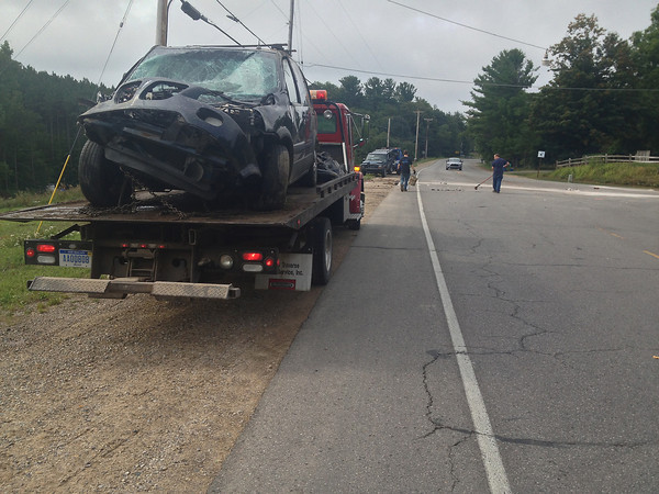 Record-Eagle/Matt Troutman<br /> A Pontiac minivan and Jeep Cherokee are towed from the scene of a four-vehicle crash Thursday at the intersection of West Silver Lake Road and Secor Road.