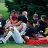 Record-Eagle/James Cook<br /> Traverse City Central players take a break during Tuesday morning's practice. It was hot at the practice — 87 degrees on the MHSAA's newly-imposed heat index — but not high enough to mandate extra water breaks during practice sessions. Today's highs are supposed to be in the 90s, but a forecast of windy conditions should help keep the heat index in workable range.