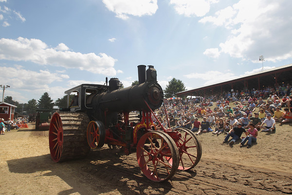 Record-Eagle/Keith King<br /> A 1911 Avery steam tractor owned by Tom Graham, of East Jordan, travels in the Big Parade of All Vehicles Saturday, August 17, 2013 during the 46th annual Buckley Old Engine Show.