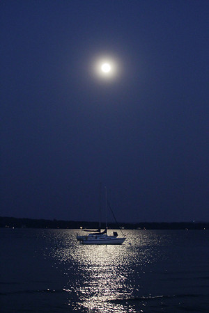 Record-Eagle/Keith King<br /> Sailboats are visible as the Blue Moon rises Tuesday, August 20, 2013 over West Grand Traverse Bay in Traverse City.