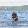 Record-Eagle/Keith King<br /> Jack Nowland, owner of SOS Analytical, collects a water sample Wednesday, August 14, 2013 in West Grand Traverse Bay.