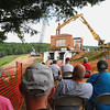 Spectators watch the deconstruction of the powerhouse atop Brown Bridge Dam on Friday, Aug. 24, 2012.