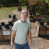 Record-Eagle/Keith King<br /> Kirk Jones, general manager of Sleeping Bear Farms, stands Friday, August 17, 2012 at an apiary of Italian honeybees in Homestead Township.