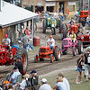 Record-Eagle/Jan-Michael Stump<br /> Tractors of all makes and models parade through the grounds of the Buckley Old Engine Show on Saturday.