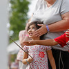 Record-Eagle/Jan-Michael Stump<br /> May Kay Kolber, center, of Grand Rapids covers the ears of her 3-year-old granddaughter, Karissa Lucas, as Karissa's brother, Jackson Ward, 7, reaches to help her pull a cord so she can make the joyful noise.