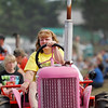 Record-Eagle/Jan-Michael Stump<br /> Arlene Kolbe, of Hesperia, drives a pink tractor for breast cancer awareness in a tractor parade Saturday at the Buckley Old Engine Show.
