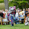 Record-Eagle/Jan-Michael Stump<br /> Donovan Waupoose dances in the grand entry of the Peshawbestown Traditional Pow Wow.