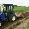 """Record-Eagle/Keith King<br /> Cletus Lautner, of Long Lake Township, uses a tractor to work in his garden. """"I'm 88 years old and I've lived here for 88 years,"""" Lautner said regarding the time he's lived at his farm."""