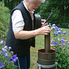 Record-Eagle/Marta Hepler Drahos<br /> National Weather Service cooperative observer Hazel Evans prepares to measure precipitation from a rain gauge at her home near Beulah.