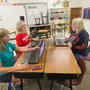 Record-Eagle/Keith King<br /> Toni Manning, from left, Penny Emeott and Julie Smith, teachers at Suttons Bay Elementary School, work on presentations for the start of the school year.
