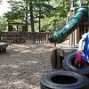 Record-Eagle/Michael Walton<br /> Ariella Baker, 3, plays on a tire bridge at the Grand Traverse County Civic Center's Kids Kove playground.
