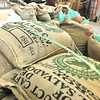 Record-Eagle/Nathan Payne<br /> Bags of unroasted coffee sit in a pile at the center of Great Northern Roasting Company's production facility. The company's owner and roastmaster, Jack Davis, has watched many fluctuations in the coffee market during his 13 years of roasting.