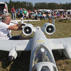 Record-Eagle/Keith King<br /> Ted McClellan, of Interlochen, cleans a turbine pod on his A-10 Thunderbolt model jet Saturday, August 24, 2013 as the Benzie Area Remote Control (BARC) club hosts the Academy of Model Aeronautics (AMA) model air show at the Thompsonville Airport. Proceeds from the event are to go toward the Wounded Warrior Project.