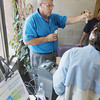 Record-Eagle/Keith King<br /> Gary Vidor, trainer with the Bay Area Transportation Authority (BATA), explains Wednesday, August 21, 2013 at the BATA transfer station on Hall Street, how to use the electronic fare boxes which are expected to be utilized on the BATA Loop and Link buses beginning August 26.