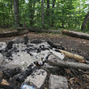 Record-Eagle/Keith King<br /> A beer can and a remnant of a beer bottle are visible near evidence of a fire Tuesday, August 13, 2013 near North Twin Lake.