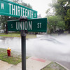 Record-Eagle/Keith King<br /> Vehicles travel in rainy conditions Tuesday, August 27, 2013 on Union Street at Thirteenth Street in Traverse City.