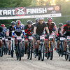Record-Eagle/Keith King<br /> Racers take off from the starting line at Ranch Rudolf Saturday, August 24, 2013 during the X100 mountain bike race.