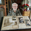 Record-Eagle/Keith King<br /> Harry Elletson, of East Bay Township, sits near a scrapbook which shows a photo of a radar station he served at in Sault Ste. Marie, left, and photos of him serving as a dentist at the Empire, Mich. United States Air Force radar station. Elletson served there from 1958 to 1960.