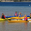 Record-Eagle/Jan-Michael Stump<br /> From left, Max Evans, Eric Chapman, Ashley Gransden, Morgan Jarvis and Elliot Evans will be among those in the Suttons Bay Flotilla will attempt to break the Guiness Book of World Records by gathering over 2,000 kayaks and canoes together in Suttons Bay at 1 p.m. on Saturday, Sept 1, 2012 to raise money for the community's school system.