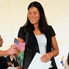 Record-Eagle/Jan-Michael Stump<br /> Safya Bellachia receives an American Flag after being sworn in as a United State citizen during Friday's naturalization ceremony at the Sleeping Bear Point Coast Guard Lifesaving Station in Glen Haven.
