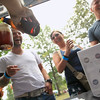 Record-Eagle/Jan-Michael Stump<br /> From left, Marcus Kingsland, Sheena Lee (cq) and Ted Lee of Durand sample beers from Frankenmuth Brewery Friday during the 4th Annual Traverse City Summer Microbrew and Music Festival.
